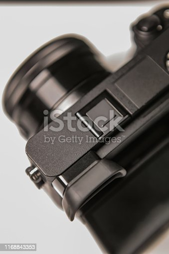 Modern mirrorless camera on white background