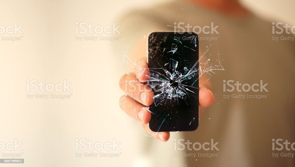 modern mobile smartphone broken screen and damages. Cellphone crashed and scratch. Device destroyed stock photo