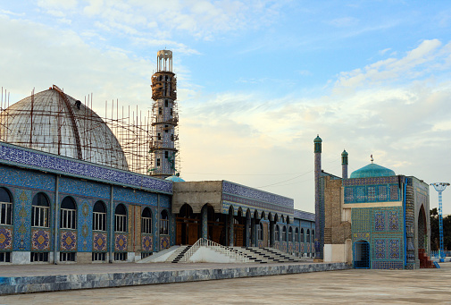 Mazar-i-Sharif, Balkh province, Afghanistan: 20th century mosque and scaffolding at the ancient Shrine of Ali (Hazrat Ali Mazar) compound - aka Blue Mosque or Rauza, considered (mainly by the Afghans) as the burial place of Ali ibn Abi Talib, cousin of Mohammed. He was the first male follower of Muhammad and married his daughter Fatima. Ali was the fourth Rightly Guided caliph and the first Imam of Shia Muslims.
