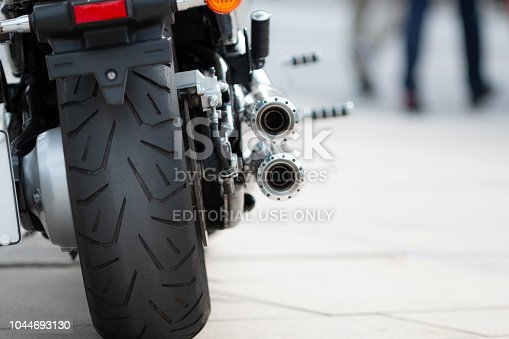 Hamburg, Germany - September 16. 2018: Closeup of a modern motorcycle with huge rear wheel, parked on a public parking lot in Hamburg, Germany