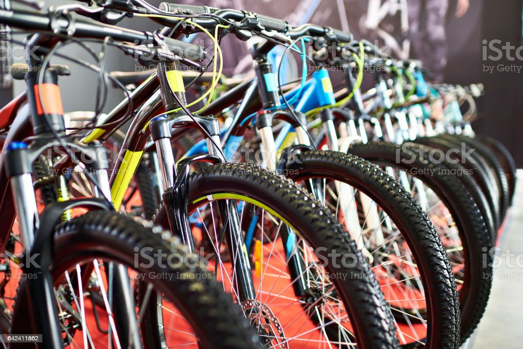Modern mountain bikes in sports shop stock photo