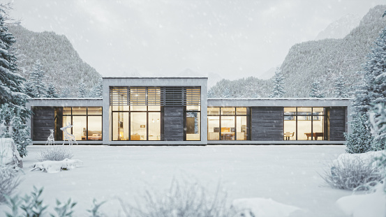 Modern Mountain House In Snowy Weather
