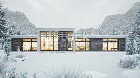 Contemporary mountain villa in winter season with snow.