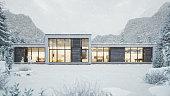 Contemporary mountain villa in winter season with snow.