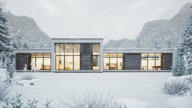Modern Mountain House In Snowy Weather Contemporary mountain villa in winter season with snow. chalet stock pictures, royalty-free photos & images