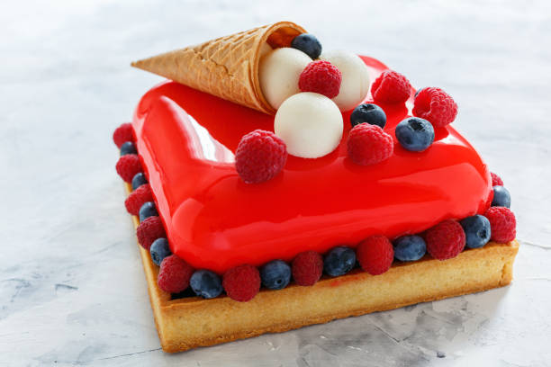 Modern mousse cake with red glaze. stock photo