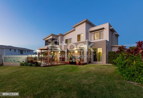 istock Modern multilevel house exterior with pool 909423306
