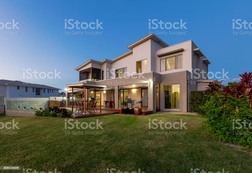 Modern multilevel house exterior with pool stock photo