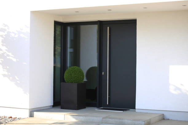 Modern new anthracite grey front door Modern new anthracite grey front door front door stock pictures, royalty-free photos & images