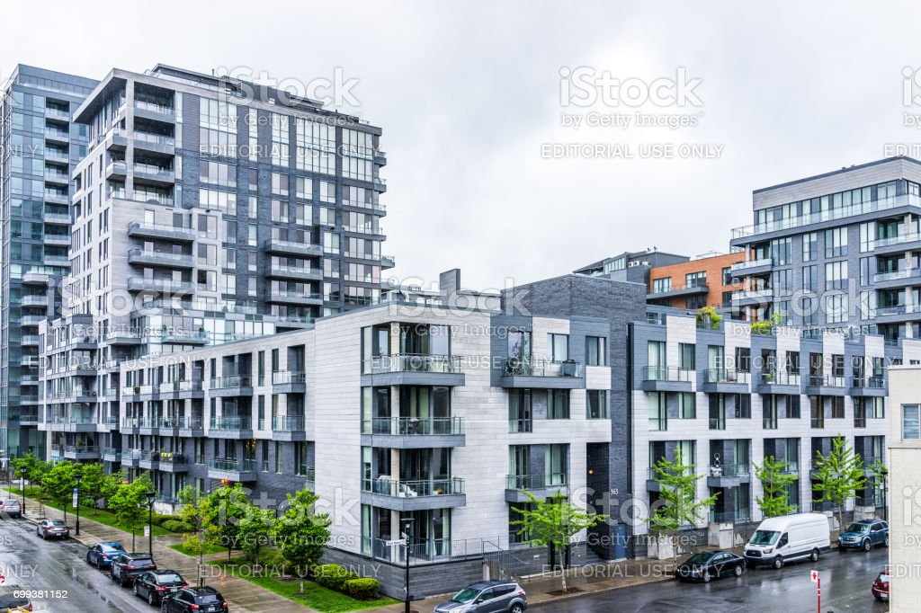 Modern new apartment condos in city in Quebec region during rainy cloudy wet day stock photo