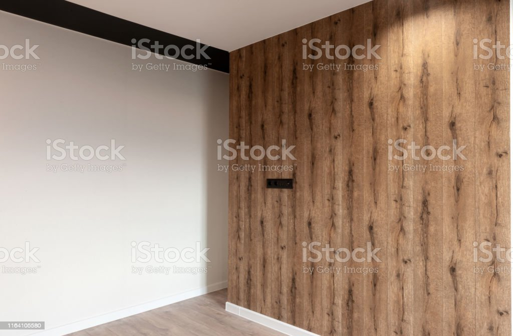 Modern New Empty Room With White And Wood Walls And Hardwood Floor