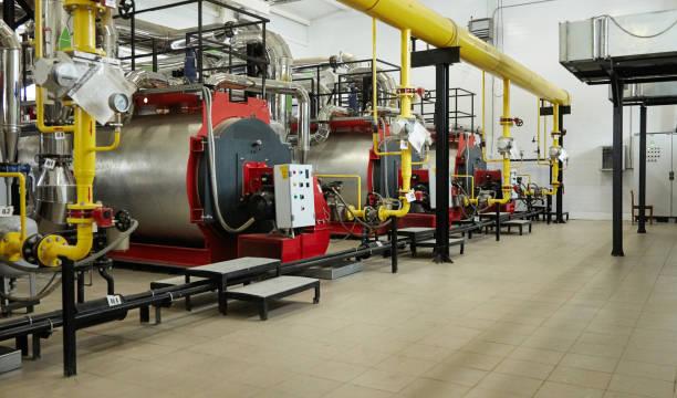 moderne neue gas heizung kessel arbeiten in einem heizraum. - boiler stock-fotos und bilder
