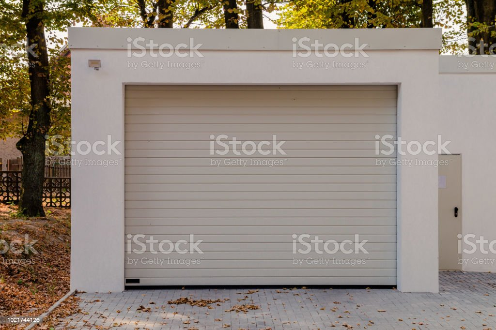 modern new white garage with roller shutter