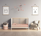 Modern nursery room with salmon red and greyaccents