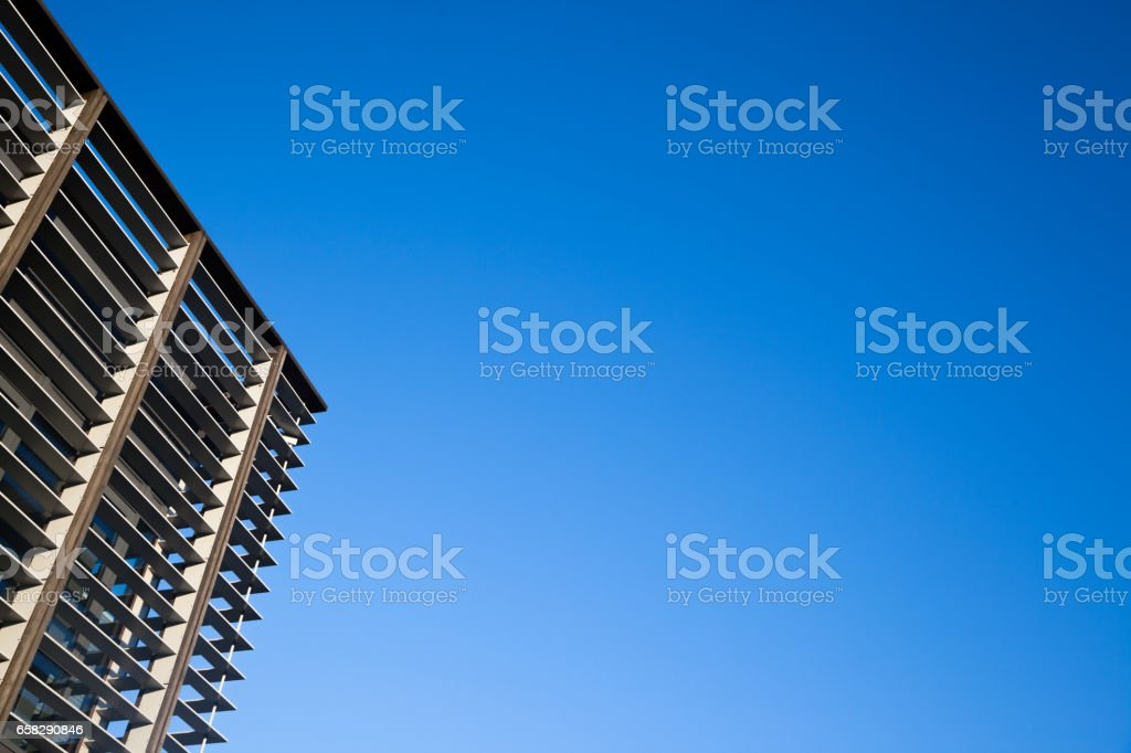 modern office building architecture United Kingdom against blue sky stock photo
