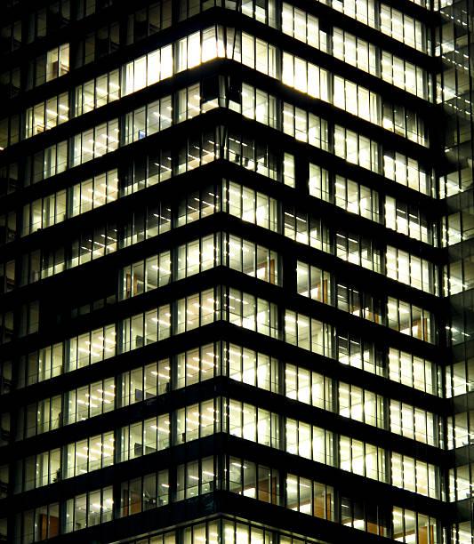 Modern office building at night stok fotoğrafı