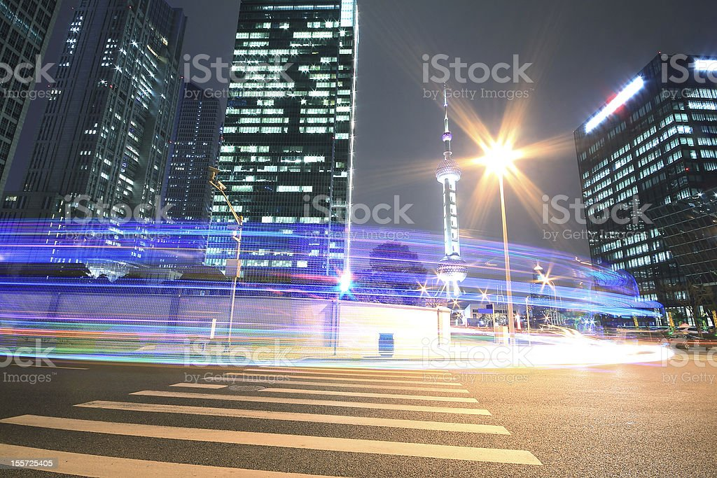 Modern office building background of car night with light trails royalty-free stock photo