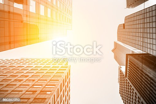 istock Modern office building close up in sunlight with B&W color 860352050