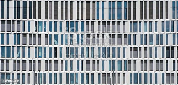 istock modern office building facade - architectural pattern 812058022