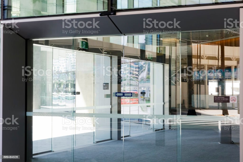 Modern office building glass door with reflection, backgound, copy space stock photo