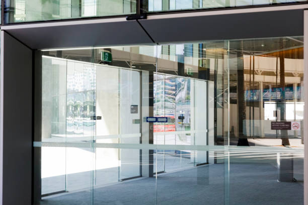 modern office building glass door with reflection, backgound, copy space - entrance stock photos and pictures