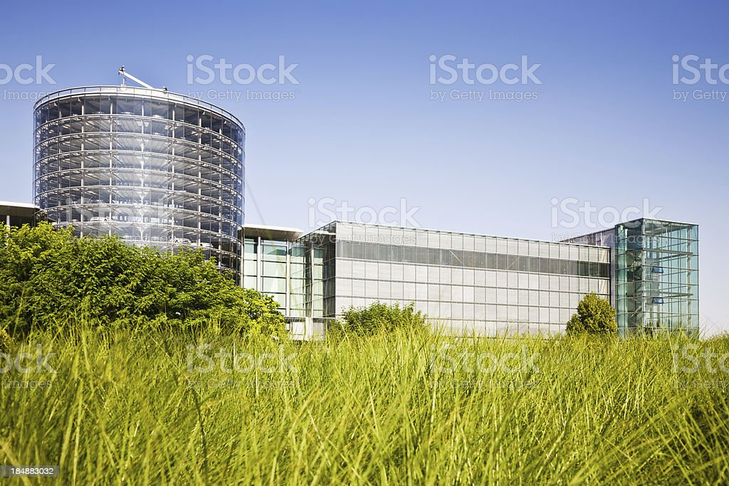 Modern Office Building Glass Facade in Green Environment royalty-free stock photo