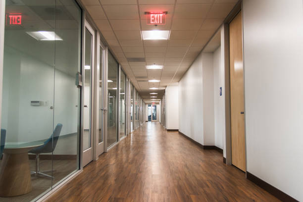 modern office building hallway - exit sign stock photos and pictures