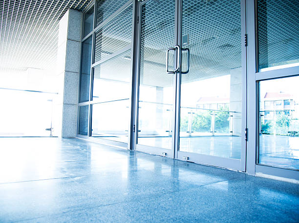 modern office building - entrance stock photos and pictures