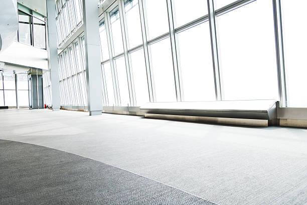 moderne bürogebäude - eingangsbereich teppich stock-fotos und bilder