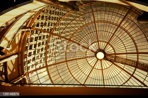 istock Modern Office Building Seen Through Glass Roof 125145374