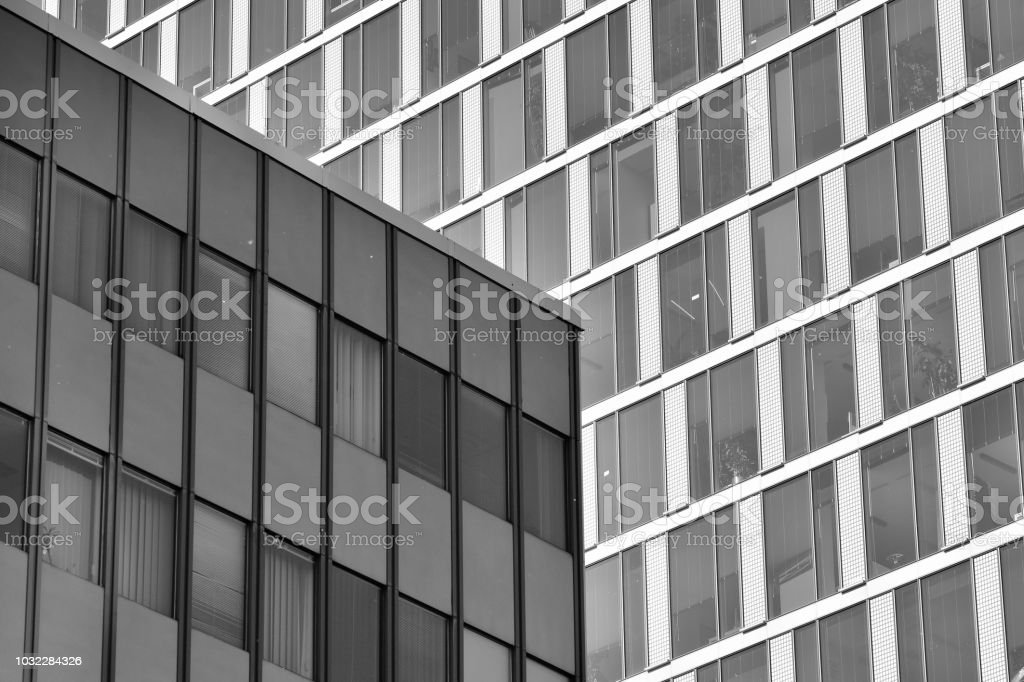 Modern office building wall made of steel and glass. Black and white. stock photo