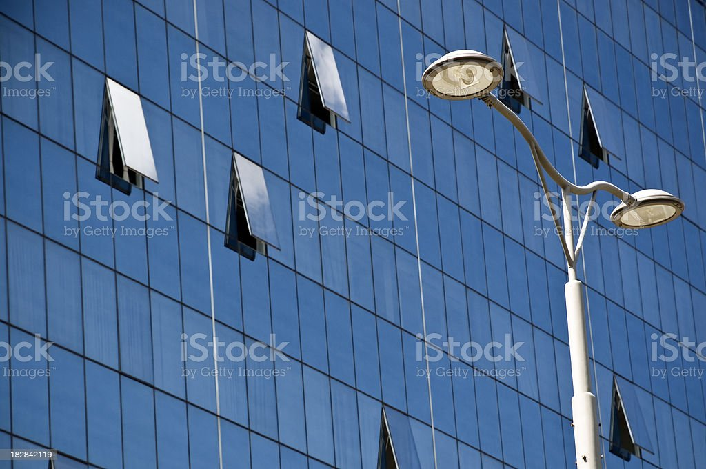 Modern Office Building With a Street Light royalty-free stock photo