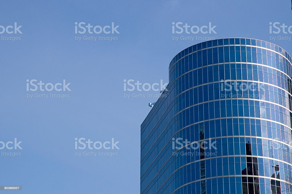 Modern office building with blue skies behind royalty-free stock photo