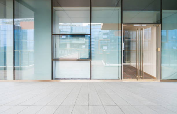 A modern office building with glass doors and windows stock photo
