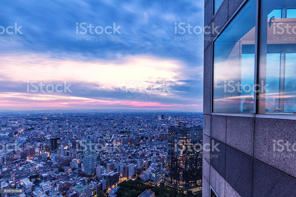 modern office building with skyline during sunset stock photo