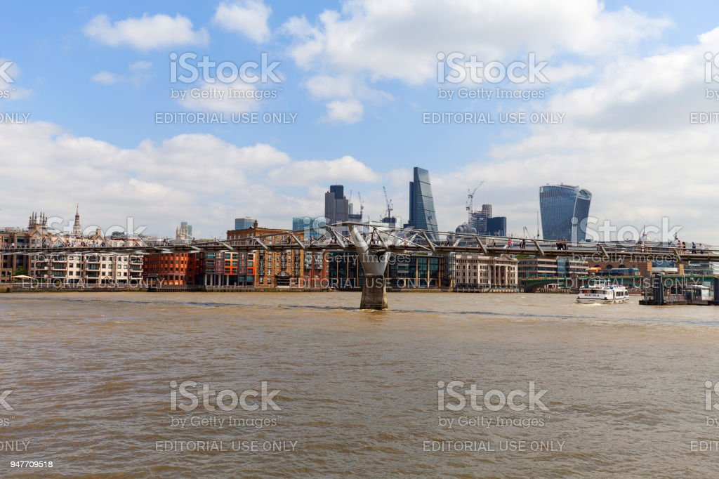 Modern office buildings in London, central business district, City of London, London, United Kingdom. View from the river Thames with Millennium Bridge stock photo