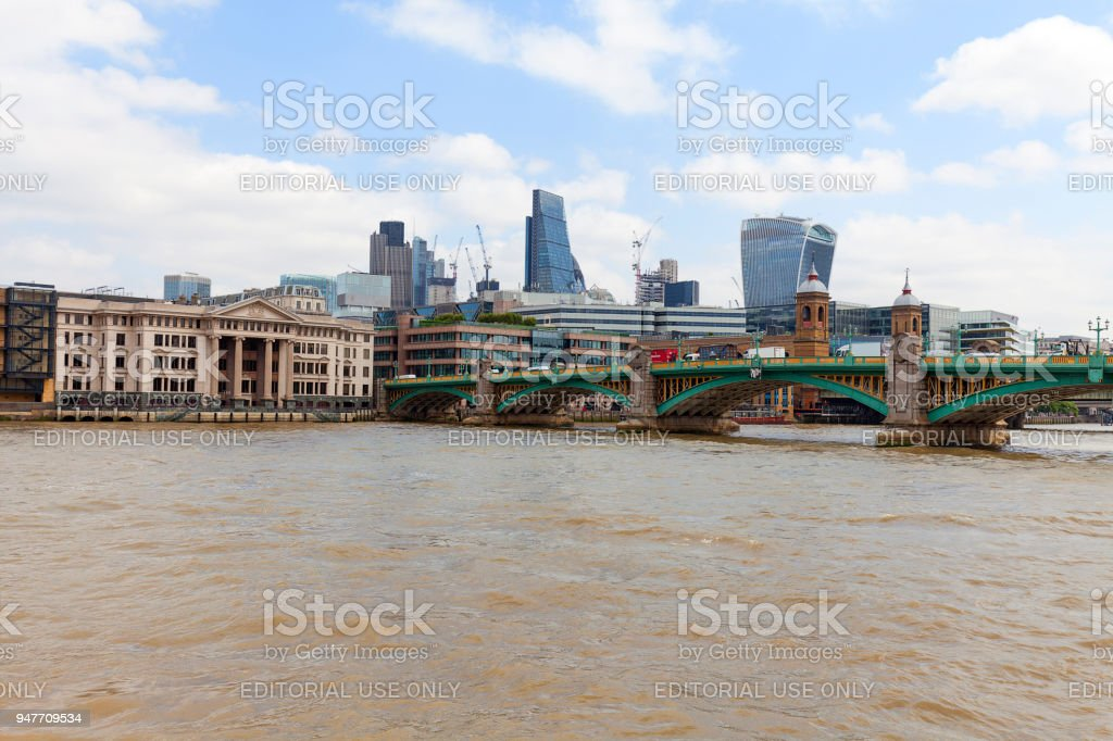 Modern office buildings in London, central business district, City of London, London, United Kingdom. View from the river Thames with Southwark Bridge stock photo