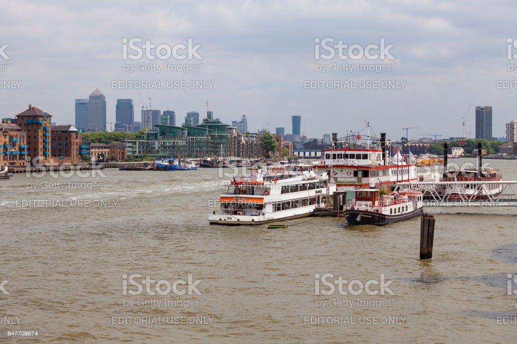 Modern office buildings in London, central business district, City of London, London, United Kingdom. View from the river Thames tourist ships stock photo