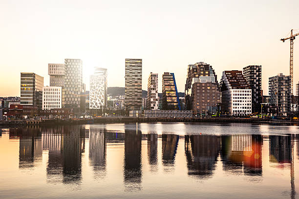 Modern office buildings in Oslo Oslo modern skyline. Several buildings built on the water's edge in the Norwegian capital city. Reflections on the water. oslo stock pictures, royalty-free photos & images