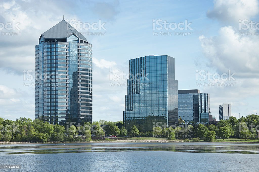 Modern office buildings with lake in foreground stock photo