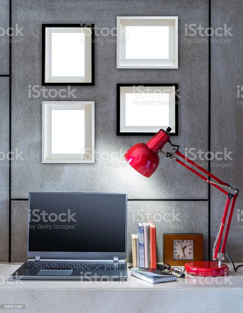 Modern Office Desk With Laptop Lamp And Blank Picture Frames Stock