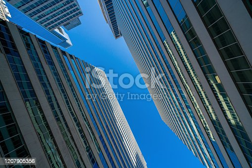 490774222 istock photo Modern office glasses buildings cityscape under blue clear sky in Washington DC, USA 1207905356