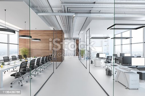 Modern office interior, many work stations with desktop computer and large LCD screen. White floor and minimalist materials. no people, template copy space render