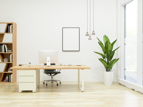 istock Modern Office Interior with Frame showing blank screen 1065300306