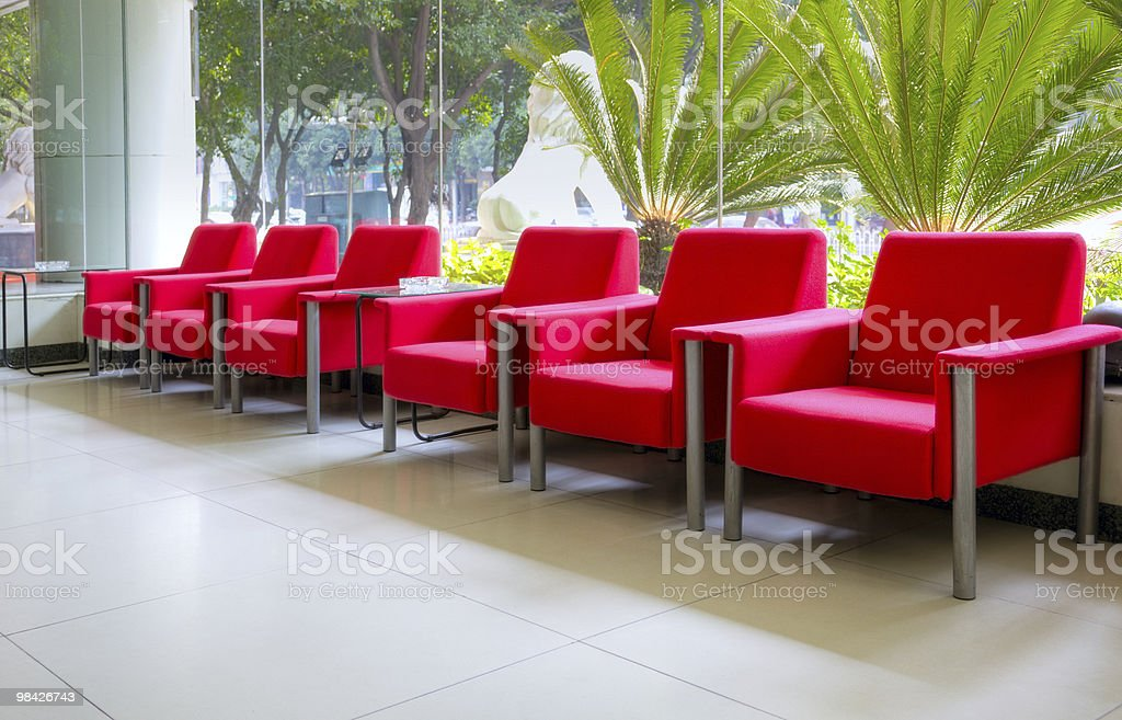 Modern office interior with red sofa chairs royalty-free stock photo