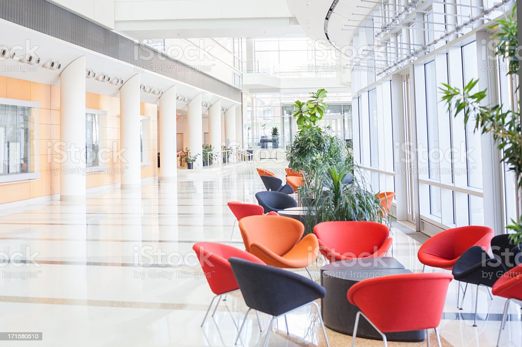 Modern office lobby with colorful seats stock photo