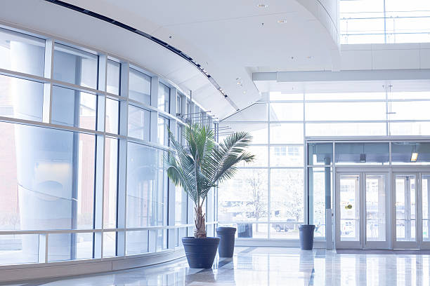 modern office lobby with glass wall - building entrance stock photos and pictures