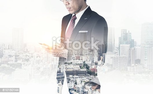 istock modern office man with dark suit, double exposure effect with Japan city skyline background 810150144