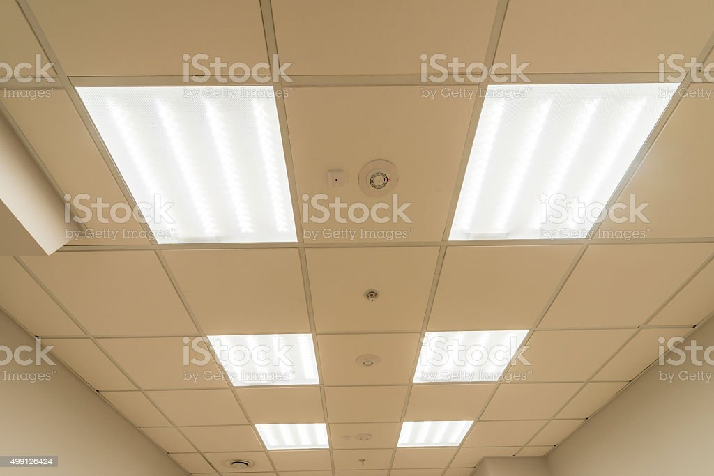 Modern office space with fluorescent lamps stock photo