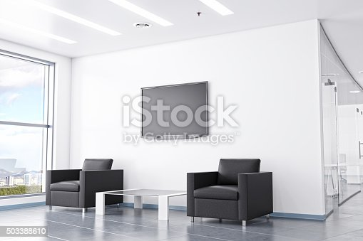 Modern office waiting area interior design with modern black leather arm chairs, contemporary coffee table, led tv and large windows with cityscape.